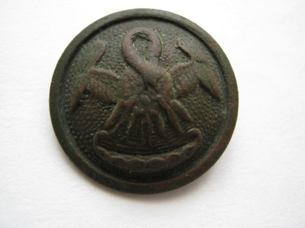 Pelican button antique