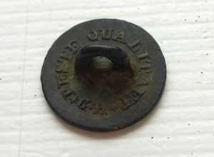 Napoleon button. Back side, embossings of producer.